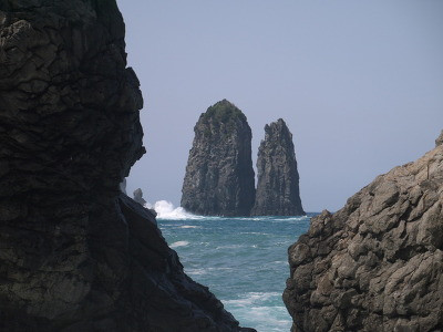 Ulleung-Do (also spelled Ulreungdo; Korean pronunciation: [ulːɯŋdo]) is a South Korean island far off the east coast of Korean Peninsula. Formerly known as Dagelet to the Europeans, [1] Ulleungdo is about 120 km (75 mi) east of the Korean Peninsula. Volcanic in origin, the rocky steep-sided island is the top of a large stratovolcano which rises from the seafloor, reaching a maximum elevation of 984 metres (3,228 ft) at Seonginbong Peak.